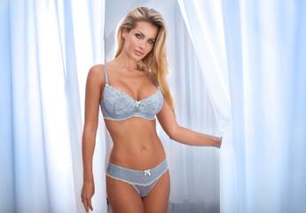 Sensual lady in lingerie posing.