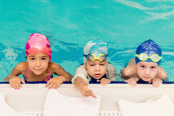 Cute children in the swimming pool