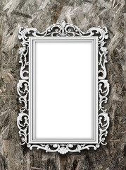 Single blank silver Baroque picture frame on wooden background