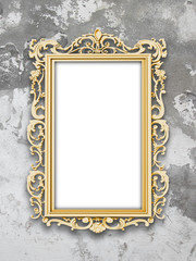 Single blank golden Baroque picture frame on gray weathered concrete wall background