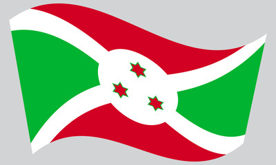 Flag of Burundi waving on gray background