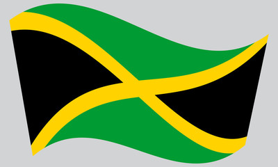 Flag of Jamaica waving on gray background