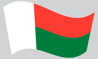 Flag of Madagascar waving on gray background