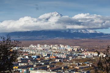 Kamchatka autumn view of city landscape of Petropavlovsk-Kamchatsky City on background beautiful active Koryaksky Volcano. Kamchatka Region, Russian Far East, Eurasia.