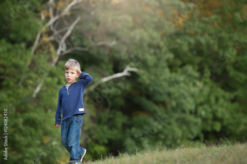 """blonde boy walking alone and sad in the woods"" Stock ..."