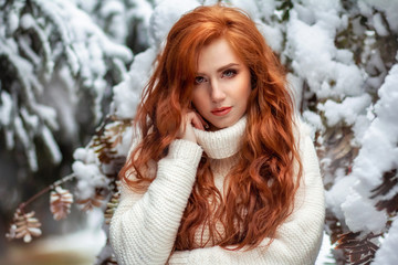 The red-haired young woman in the winter wood