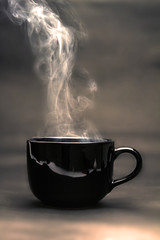 the warm black cup of coffee