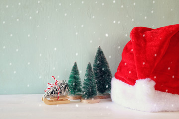 Image of christmas trees next to santa hat