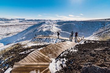 panoramic view from the volcano grabrok at wintertime with group of tourists