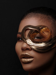 Fototapete - Fashion art studio portrait of an extraordinary beautiful nude african american model with perfect smooth glowing mulatto skin, make up, full golden lips, shaved haircut and gold jewelry, profile