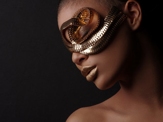Fototapete - Glamour art studio portrait of an extraordinary beautiful nude african american model with perfect smooth glowing mulatto skin, make up, full golden lips, shaved haircut and gold jewelry, profile