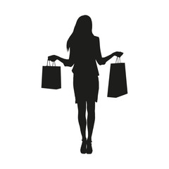 Woman standing and holding shopping bags. Isolated vector silhou