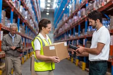 Female worker holding cardboard box