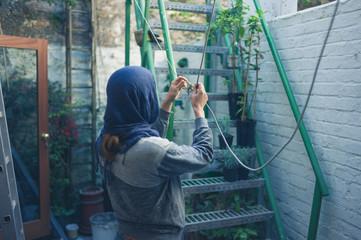 Young woman fixing washing line