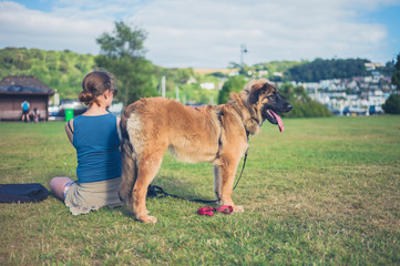 Woman with big dog in the park