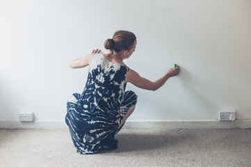 Young woman cleaning wall