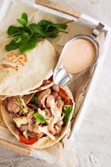 Greek pita bread with meat and salad