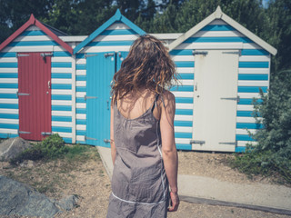 Young woman by beach huts