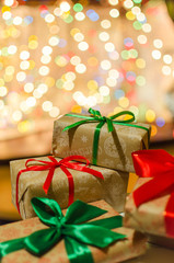 christmas gifts indoor on defocused lights background space for text