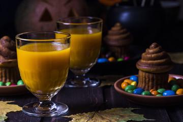 Halloween cocktail, pumpkin orange drink with spices