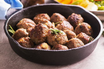 Beef meatballs in an iron skillet
