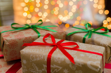 christmas gift boxes indoor on defocused lights background space for text