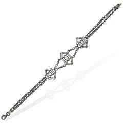 Silver bracelet with zircon stones on white