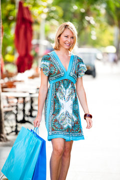 Woman with shopping bags at Lincoln Road outdoor mall