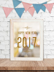 Happy new year 2017 on white wooden frame