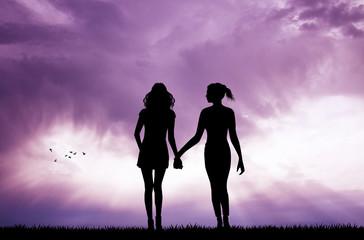 pair of women at sunset
