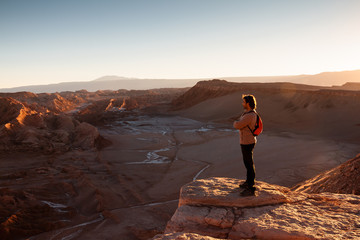 Tourist standing at the edge of canyon.