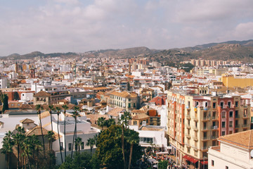 Rooftop view of Malaga city (Spain), as seen from the palatial fortification Alcazaba on top of a hill.