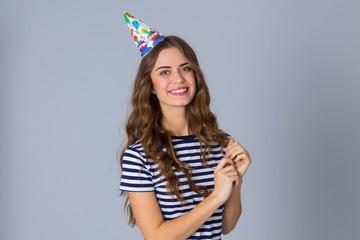 Smiling woman in celebration cap