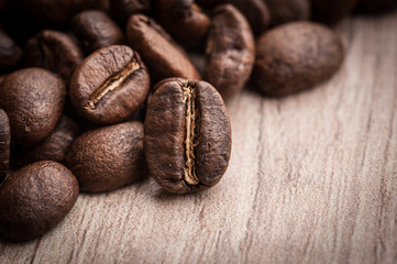roasted coffee beans on wooden background, can be used as a background