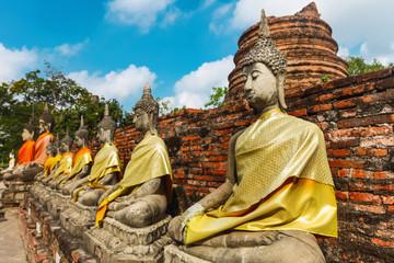 Rows of buddha statue Wat Yai Chaimongkhon, Ayuthaya, Thailand