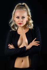 Beautiful topless woman in the black jacket
