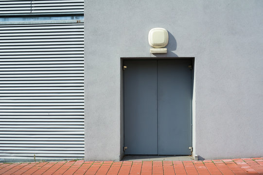 Detail of grey simple minimalist building with door - geometry of angular lines and copy space
