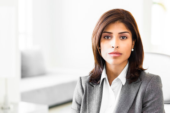 Attractive young woman latin hispanic lawyer businesswoman in office corporate lobby