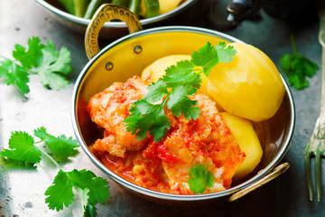 Poached Fish in Tomato Sauce