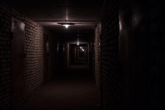 Dark long corridor hallway in a basement
