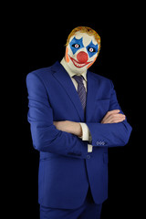 man in a suit and mask of a clown