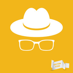 white hat with glasses on the yellow background