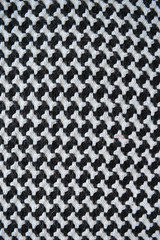 Bones / houndstooth knitted carpet background