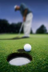 Golf ball near a hole