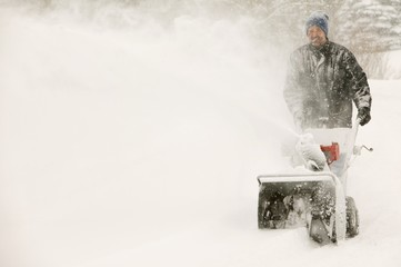 A Man Snow-Blowing