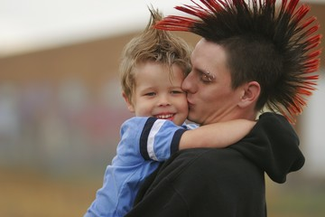 Young Man And Boy With Mohawk Hairstyles
