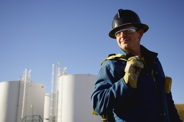 Man Working At An Oil Refinery