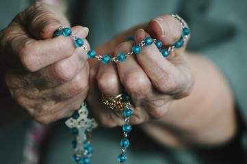 Rosary Beads In Hand