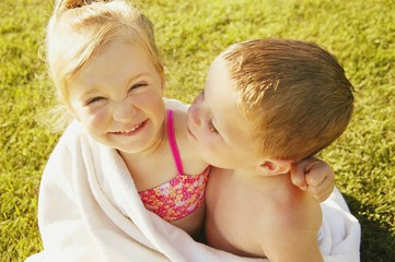 Boy And Girl Share A Towel