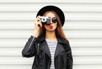 Fashion look, pretty cool young woman model with retro film came